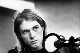 NETHERLANDS - NOVEMBER 25: HILVERSUM Photo of Kurt COBAIN and NIRVANA, Kurt Cobain recording in Hilversum Studios, playing bass guitar (Photo by Michel Linssen/Redferns)