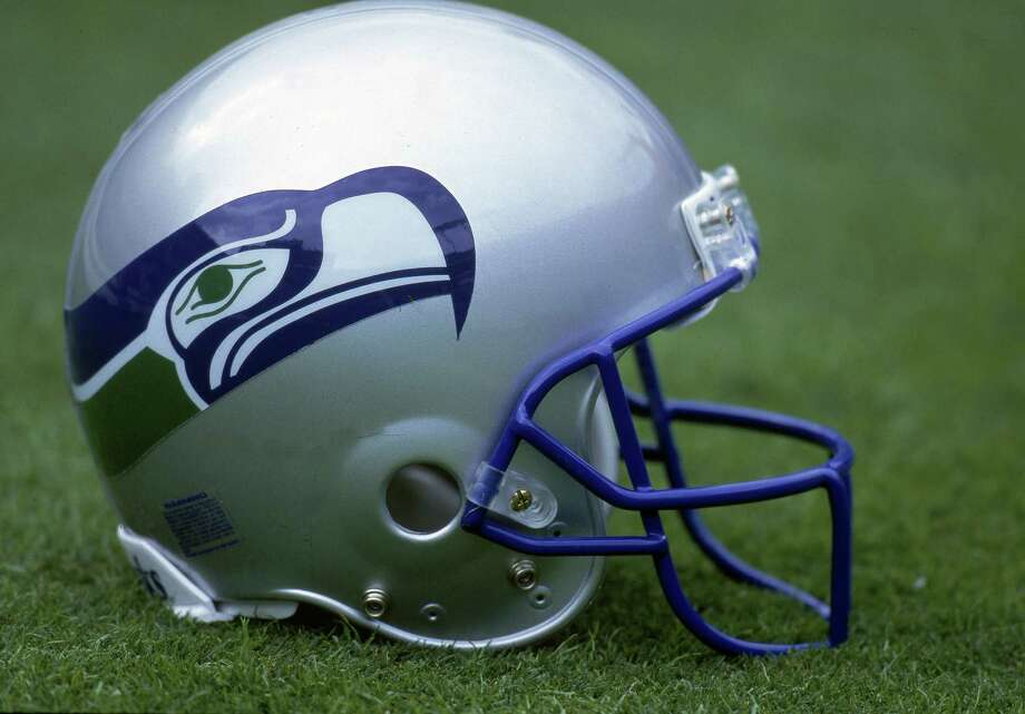 The original blue and green Seahawks logo is seen on a silver helmet. In 1983, the facemask also changed from gray to blue. Photo: Getty Images
