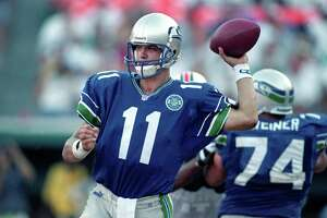 Here, the patch is seen on the Seahawks' home uniform, as worn by quarterback Brock Huard.