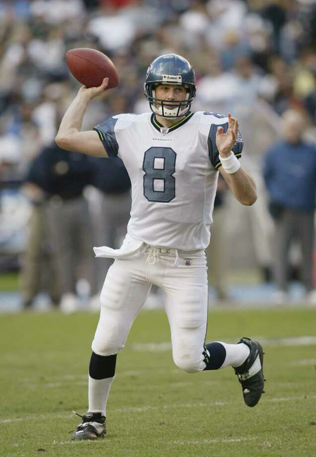 The new away uniforms were all white, as modeled here by quarterback Matt Hasselbeck. Photo: Stephen Dunn, Getty Images / 2002 Getty Images