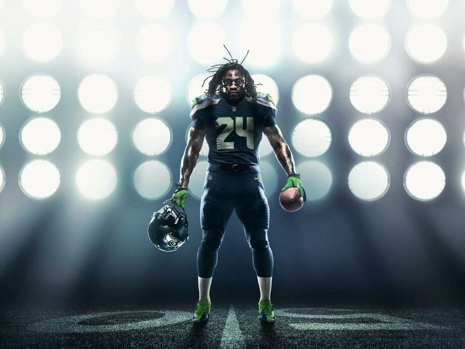 On April 3, 2012, Nike unveiled brand new uniforms for the Seahawks. While the entire NFL got updated unis as Nike took over for the whole league, Seattle got the biggest makeover. Here's Marshawn Lynch showing off the new blue home uniform. Photo: Seahawks Image