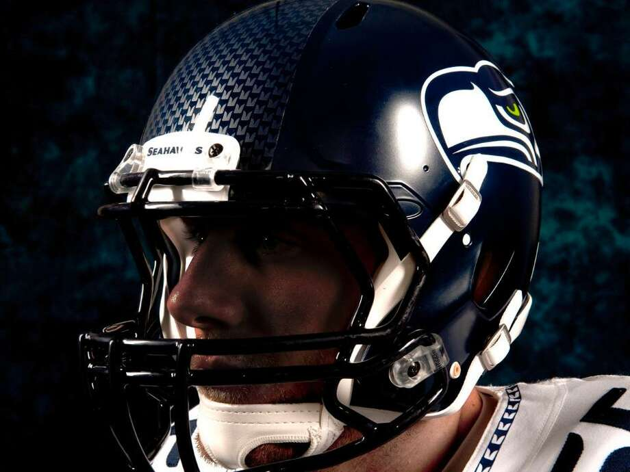 The new Seahawks helmet has a largely similar design, but features an updated Seahawks logo and a feather-textured stripe down the center. Photo: Seahawks Image