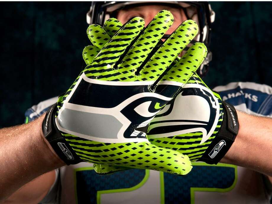 Nike's new gloves show the updated Seahawks logo, featuring a lower bar that is gray instead of light blue. Photo: Seahawks Image