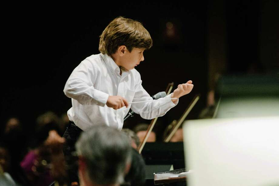 Six-year-old Jonathan Okseniuk conducts the Houston Symphony on July 10 at the Church Without Walls. Photo: Chinh Phan, Catch Light Group