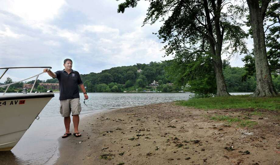 Larry Marsicano, executive director of the Candlewood Lake Authority, steps onto City Island, in Danbury, Conn., one of about 20 islands on Candlewood Lake, Thursday, July 11, 2013. Photo: Carol Kaliff / The News-Times