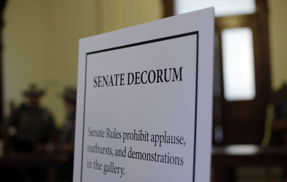 A display with rules for the gallery is seen outside the Texas Senate chambers as he final vote by the Senate is expected to begin, Friday, July 12, 2013, in Austin, Texas. The bill would require doctors to have admitting privileges at nearby hospitals, only allow abortions in surgical centers, dictate when abortion pills are taken and ban abortions after 20 weeks. (AP Photo/Eric Gay) Photo: Eric Gay, Associated Press
