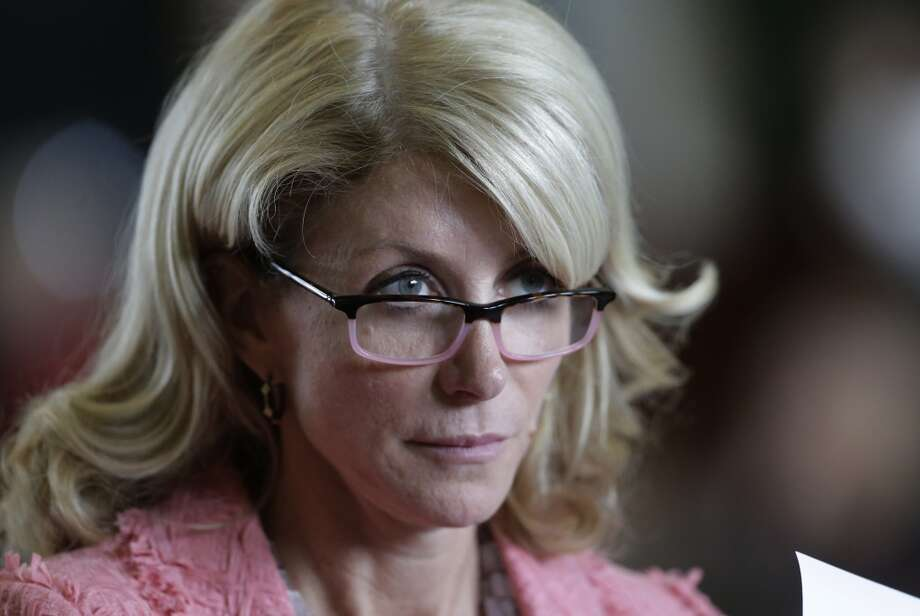 Sen. Wendy Davis, D-FortWorth, listens as the Texas Senate debate an abortion bill before the final vote, Friday, July 12, 2013, in Austin, Texas. The bill would require doctors to have admitting privileges at nearby hospitals, only allow abortions in surgical centers, dictate when abortion pills are taken and ban abortions after 20 weeks. (AP Photo/Eric Gay) Photo: Eric Gay, Associated Press
