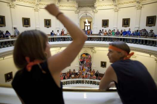 Hallie Boas and Lisa Fithian lead abortion rights chants from the third floor of the Texas Capitol Rotunda in Austin, Texas on Friday, July 12, 2013. The Texas Senate's leader, Lt. Gov. David Dewhurst, has scheduled a vote for Friday on the same restrictions on when, where and how women may obtain abortions in Texas that failed to become law after a Democratic filibuster and raucous protesters were able to run out the clock on an earlier special session. (AP Photo/Tamir Kalifa) Photo: Tamir Kalifa, Associated Press