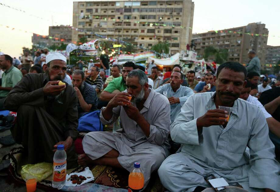 Muslim Brotherhood supporters of ousted Egyptian president Mohamed Morsi break their fast during the second day of Ramadan, the holy fasting month of Islam. Photo: Marwan Naamani / AFP / Getty Images