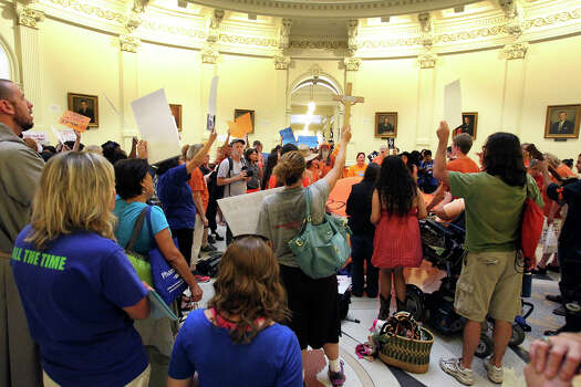 Demonstrators voice their opinion as the Capitol building fills before the Senate debates passage of abortion legislation on July 12, 2013. Photo: Tom Reel, San Antonio Express-News