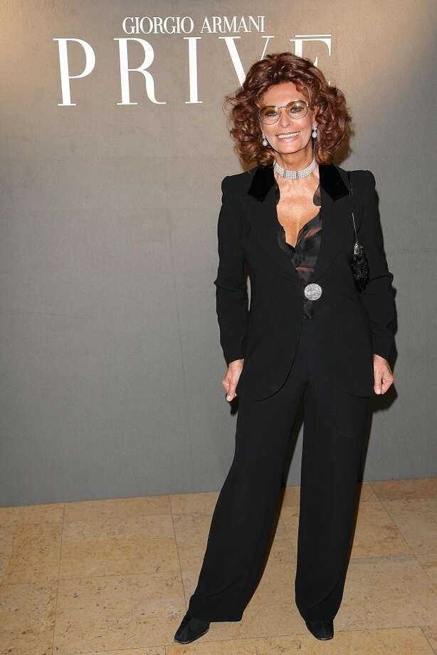 In Paris, 2008, Loren looks great in a black pantsuit. (Photo by Julien Hekimian/Getty Images)