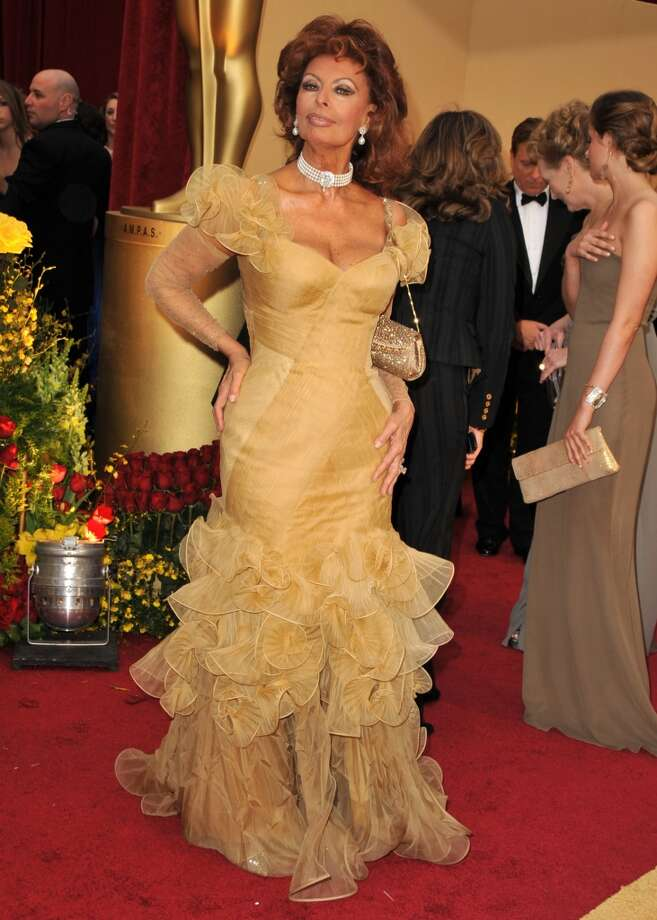 Sophia Loren arrives in a ruffled gold gown to the 81st Academy Awards at The Kodak Theatre on February 22, 2009 in Hollywood, California. (Photo by Steve Granitz/WireImage)