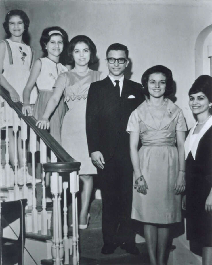 The Garcia kids pose on the stairs of their childhood home on West Gramercy Place in August, 1964. They are (from left): Sylvia, Letty, Virginia, David, Anna Maria and Rebecca. Photo: Handout, Garcia, Reader Submission