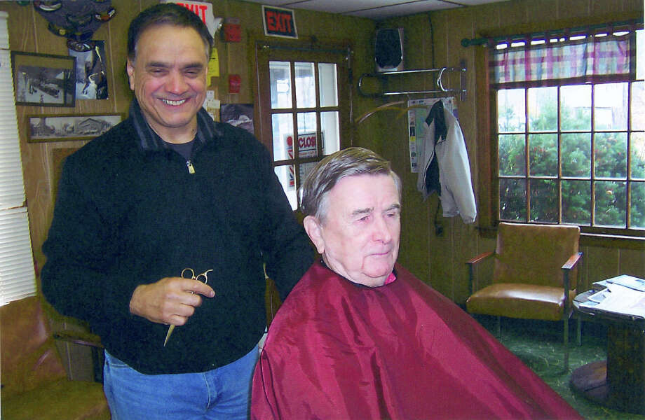 In this contributed photo longtime Brookfield, Conn.  barber Paul Gonzales cuts client and friend Bob ReynoldâÄôs hair. Gonzales died in June. Photo: Contributed Photo / The News-Times Contributed