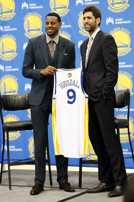 Warriors general manager Bob Myers (right) landed Andre Iguodala (left) partly on his experience as a player and agent. Photo: Rohan Smith, The Chronicle