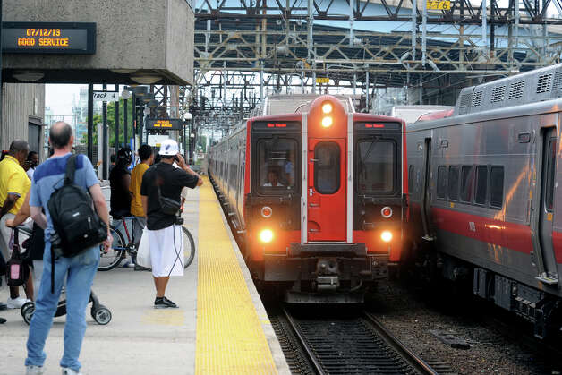 A Metro North train from New York arrives at the Bridgeport rail station, in Bridgeport, Conn., July 13th, 2013. Photo: Ned Gerard / Connecticut Post