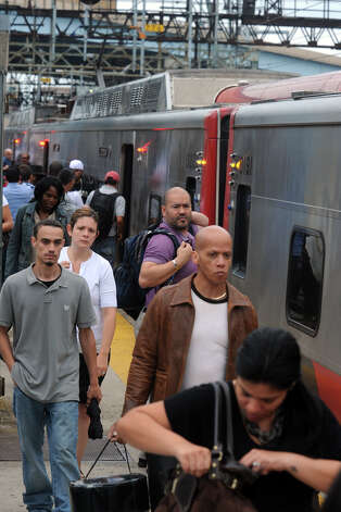 Riders exit a Metro North train from New York, in Bridgeport, Conn., July 12th, 2013. Photo: Ned Gerard / Connecticut Post