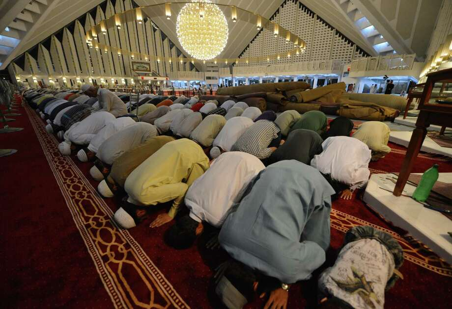 "Pakistani Muslims offer a special evening prayer, ""Taraweeh,"" on the first night of the holy month of Ramadan at the grand Faisal Mosque in Islamabad. Islam's holy month of Ramadan is celebrated by Muslims worldwide. Photo: Aamir Qureshia / AFP / Getty Images"