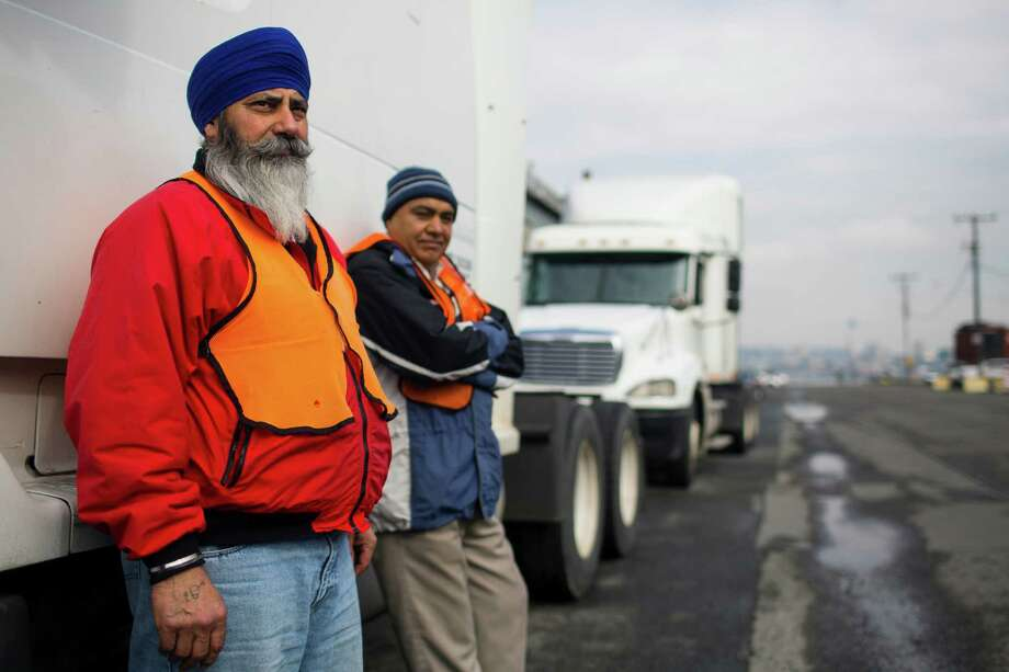 98134:  This Sodo-Harbor Island ZIP code has become significantly more white in the past decade. From 2000 to 2011, the percent of the population made up by people of color has fallen 4.6 points.Above, Paramjitsimgh Singh, left, and Balwinder Singh, center left, take a break from work Thursday, March 28, 2013, on Harbor Island in Seattle. Photo: JORDAN STEAD, SEATTLEPI.COM / SEATTLEPI.COM