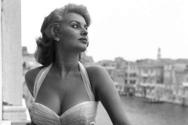 Sophia Loren stands on a terrace on the Canal Grande, wearing a white embroidered dress, Venice, 1955. (Photo by Archivio Cameraphoto Epoche/Getty Images)