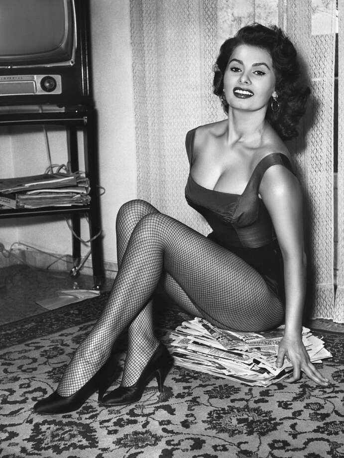 Sophia Loren poses in fishnet stockings and black pumps, circa 1955. (Photo by Diltz/RDA/Getty Images)