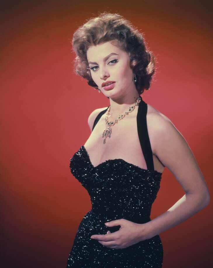Loren, pictured here in 1955, has never shied away from a low-cut tops.