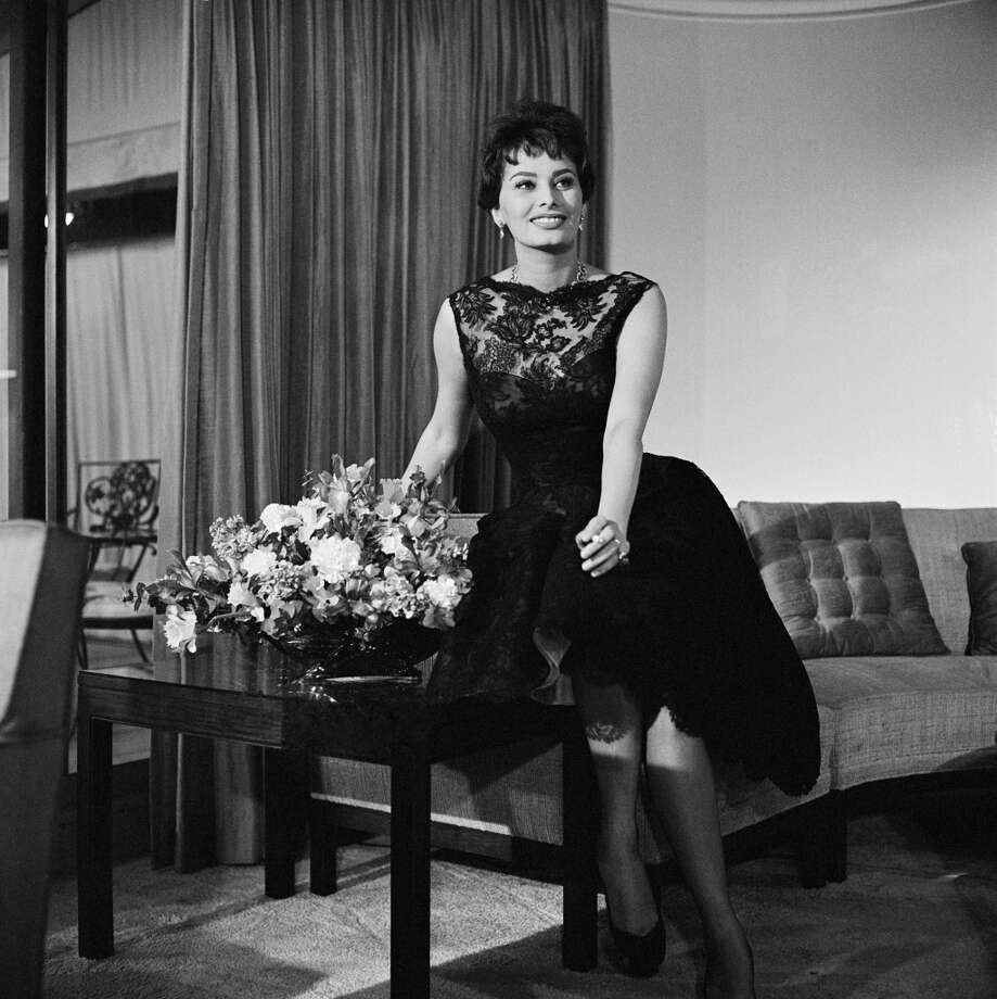 At home in a lacy dress on March 21, 1958.