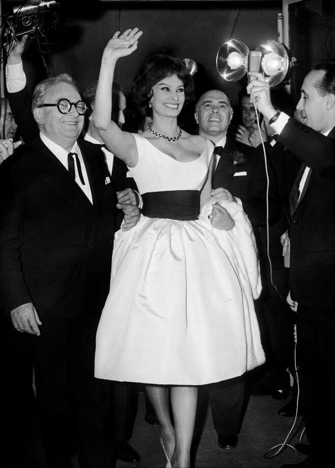 Sophia Loren, Marcel Achard and Loren's husband Carlo Ponti at the 12th Cannes Film Festival on May 14, 1959.