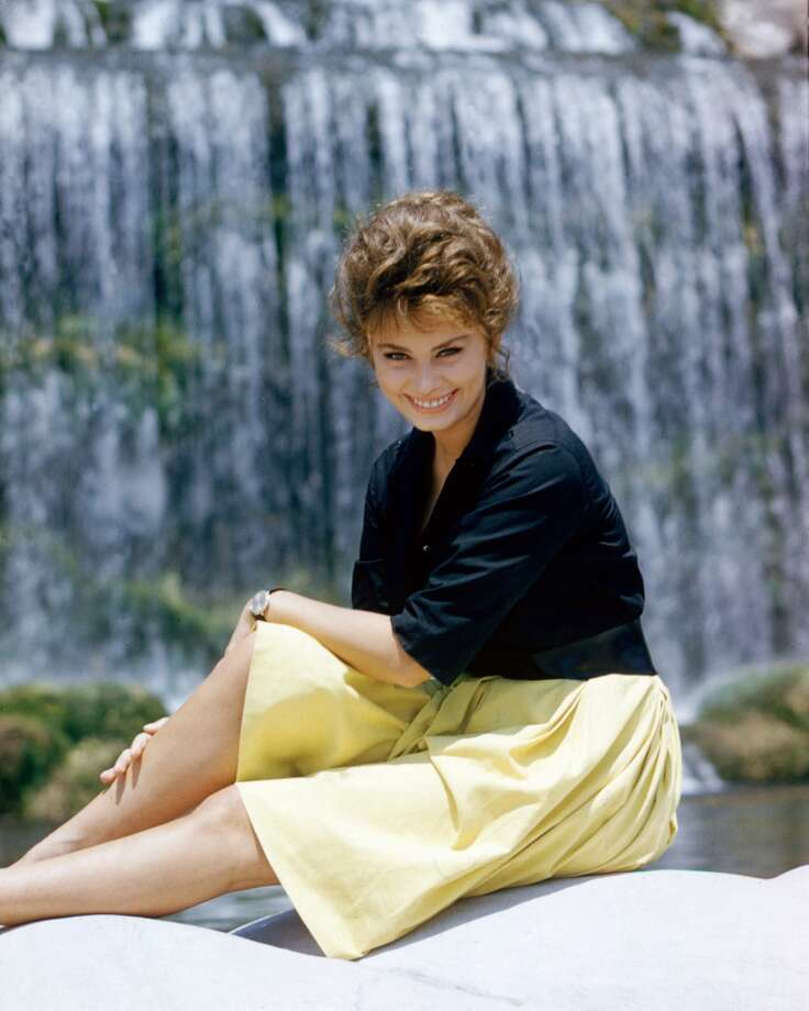 Here she is in 1960 in a  fun, light yellow skirt.
