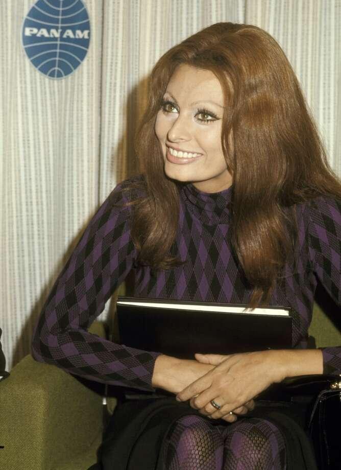 Sporting long hair on October 10, 1970 at JFK International Airport in New York City.