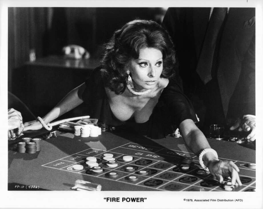 Gambling in a scene from the film 'Fire Power,' 1979.