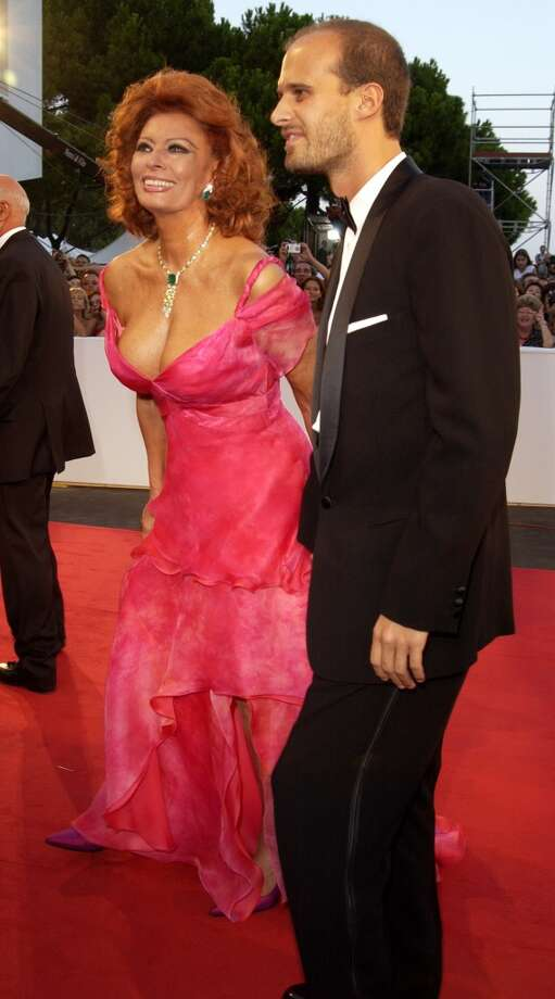 Loren, with her son Edoardo Ponti, in a bright pink gown during the 2002 Venice Film Festival at Palazzo Del Cinema in Italy. (Photo by J. Vespa/WireImage)