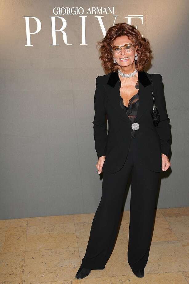 In Paris, 2008, Loren looks great in a black pantsuit. (Photo by Julien Hekimian/Getty Images)