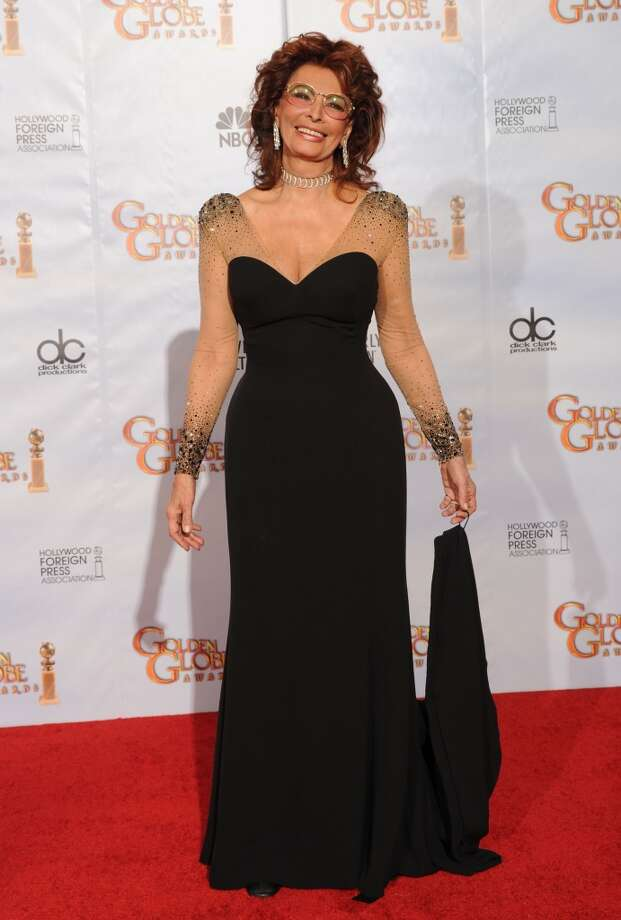 Loren's black gown, worn at the 67th Annual Golden Globe Awards in 2010, is elevated by sheer, embellished sleeves.