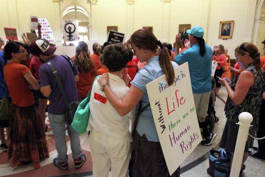 Demonstrators fill the rotunda as the Senate debates passage of abortion legislation on July 12, 2013. Photo: Tom Reel, San Antonio Express-News