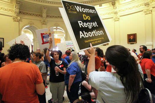 Demonstrators fill the rotunda as the Senate debates passage of abortion legislation on July 12, 2013. Photo: TOM REEL