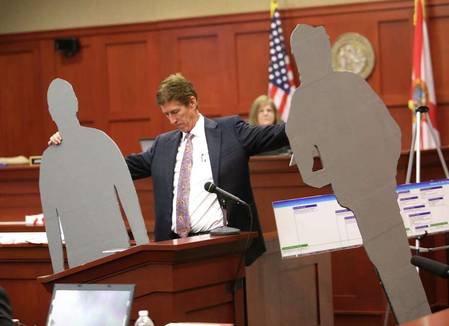 Defense counsel Mark O'Mara carried life-sized cutouts representing George Zimmerman and Trayvon Martin in the courtroom during closing arguments in the trial of George Zimmerman in Sanford, Fla. Photo: Joe Burbank, POOL / Pool Orlando Sentinel