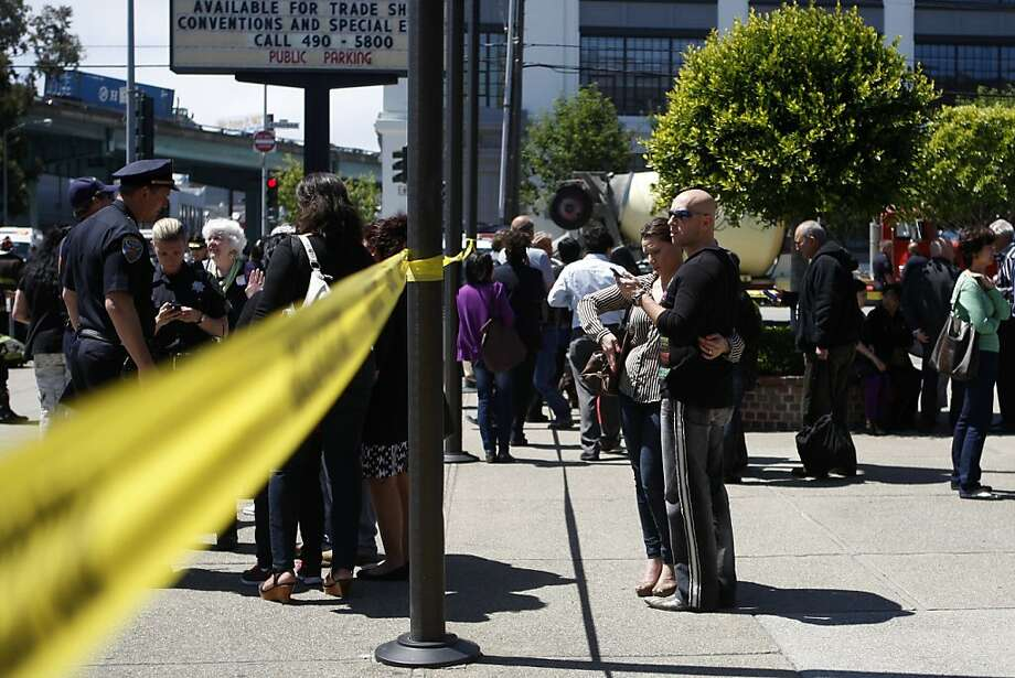 Crowds gather near the scene of Friday's double slaying at the San Francisco Giftcenter & Jewelrymart on Brannan Street. Photo: Katie Meek, The Chronicle