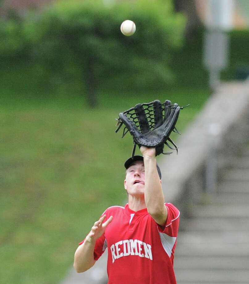 C.J. Tyler of the Redmen makes a catch in right field against BANC in the Senior Babe Ruth baseball winner's bracket final at Havemeyer Field in Greenwich, Friday evening, July 12, 2013. Photo: Bob Luckey / Greenwich Time