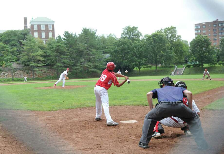 Matt Roskoff (# 18) of the Redmen goes down swinging against BANC pitcher Peter Delepine in the Senior Babe Ruth baseball winner's bracket final at Havemeyer Field in Greenwich, Friday evening, July 12, 2013. Photo: Bob Luckey / Greenwich Time