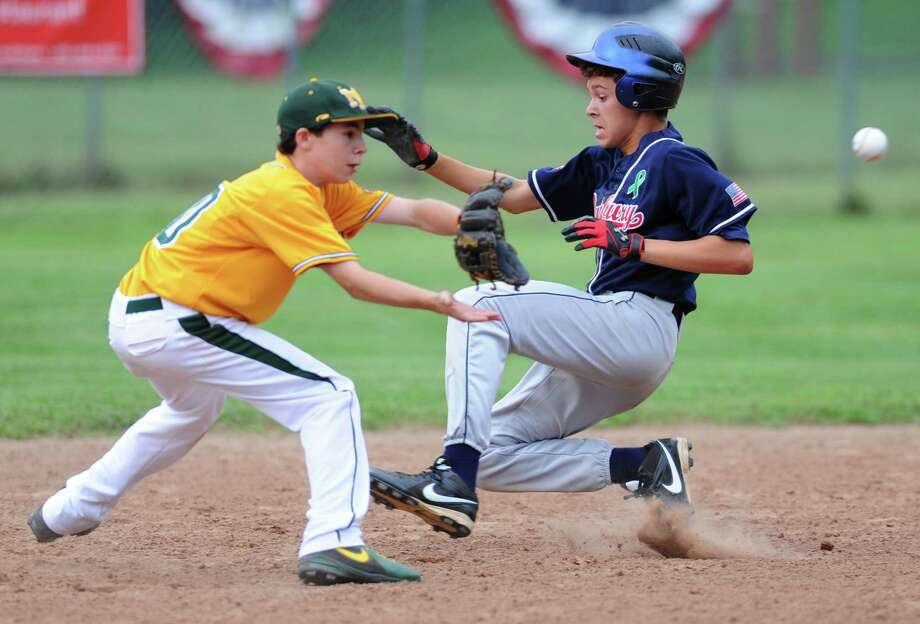 New Milford's Max Cotier attempts to tag out Danbury's Jimmy Fahey during New Milford's 10-0 win over Danbury in four innings at the Cal Ripken 12-year-old state championship at Ewald Park in Southbury, Conn. on Friday, July 12, 2013. Photo: Tyler Sizemore / The News-Times