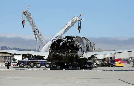 The wrecked fuselage of Asiana Airlines flght 214 sits in a storage area at San Francisco International Airport on July 12, 2013 in San Francisco, California. Nearly one week after Asiana Airlines flight 214 crash landed at San Francisco International Airport, the wrecked fuselage was moved from the runway. Two people died in the crash and hundreds were injured. Photo: Justin Sullivan, Getty Images