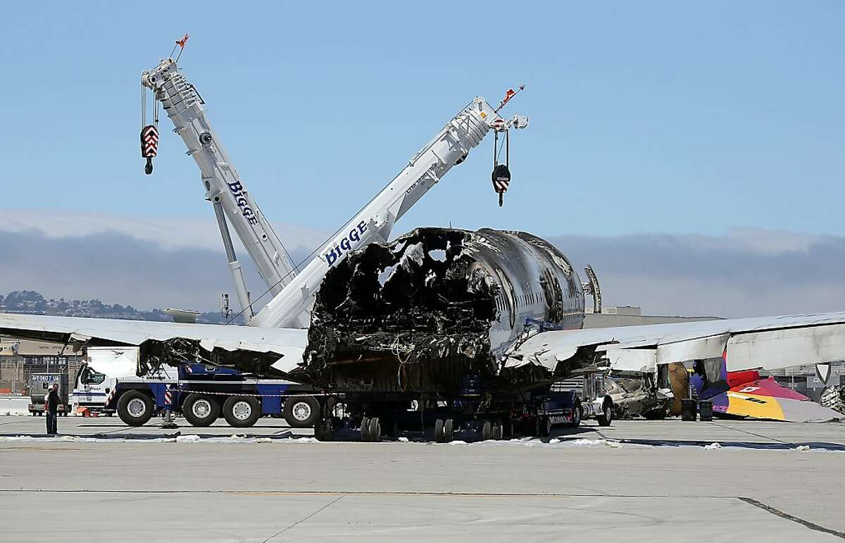 The wrecked fuselage of Asiana Airlines flght 214 sits in a storage area at San Francisco International Airport on July 12, 2013 in San Francisco, California. Nearly one week after Asiana Airlines flight 214 crash landed at San Francisco International Airport, the wrecked fuselage was moved from the runway. Two people died in the crash and hundreds were injured.