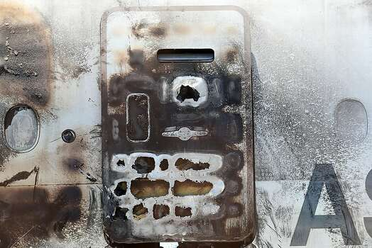A charred emergency exit door is seen on the wrecked fuselage of Asiana Airlines flght 214 as it sits in a storage area at San Francisco International Airport on July 12, 2013 in San Francisco, California. Nearly one week after Asiana Airlines flight 214 crash landed at San Francisco International Airport, the wrecked fuselage was moved from the runway. Two people died in the crash and hundreds were injured. Photo: Justin Sullivan, Getty Images