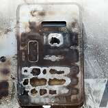 A charred emergency exit door is seen on the wrecked fuselage of Asiana Airlines flght 214 as it sits in a storage area at San Francisco International Airport on July 12, 2013 in San Francisco, California. Nearly one week after Asiana Airlines flight 214 crash landed at San Francisco International Airport, the wrecked fuselage was moved from the runway. Two people died in the crash and hundreds were injured.