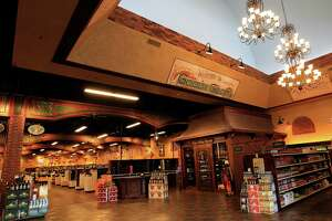 Three chandeliers hang near the front doors of Goody Goody Liquors, Wednesday, July 10, 2013, in Humble. The Dallas-based chain, at the Humble location has an interior that is fancier than most liquor stores. ( Karen Warren / Houston Chronicle )