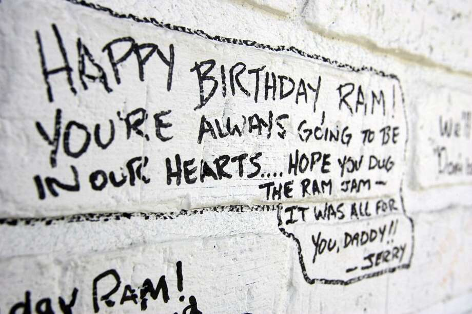 "A birthday message for Ram Ayala is written on a wall of the building that once was Taco Land Friday, June 23, 2006. Ramiro 'Ram"" Ayala was killed a year ago."