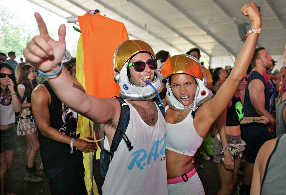 Mike Tibbitts, left, of Albany and Jenny Spitz of White Plains dance in the B.I.G. tent on day two of Camp Bisco in Mariaville, NY Friday July 12, 2013. (John Carl D'Annibale / Times Union)