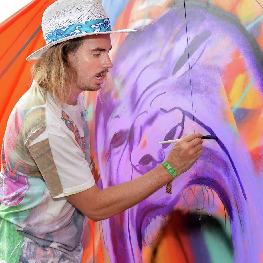 "Artist Mark Paul ""Madsteez"" Deren of Newport Beach, Calif. works on a painting during day two of Camp Bisco in Mariaville, NY Friday July 12, 2013.  (John Carl D'Annibale / Times Union) Photo: John Carl D'Annibale / 10023146A"