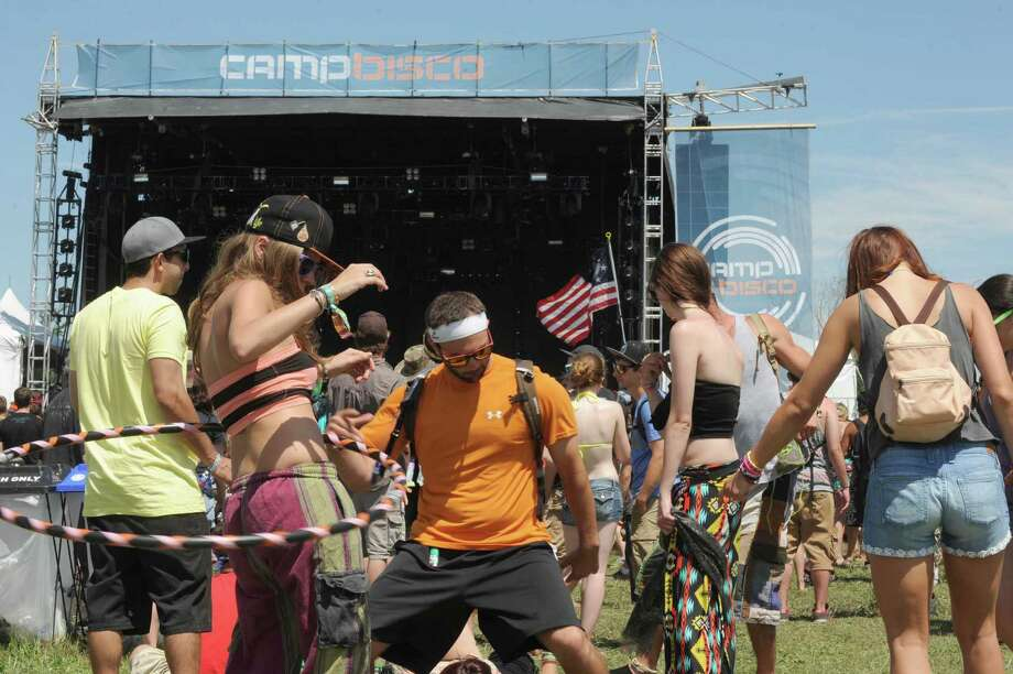 Fans dance to the sound of Digital Tape Machine during Camp Bisco on Thursday July 11, 2013 in Mariaville, N.Y. (Michael P. Farrell/Times Union) Photo: Michael P. Farrell / 00023098A